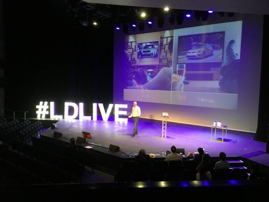 Conference speaker on stage
